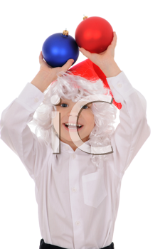 Royalty Free Photo of a Little Boy Holding Christmas Decorations