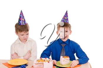 two boys eating a cake isolated on white background