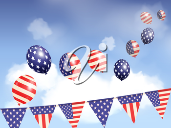 USA balloons floating in a blue sky over flag bunting
