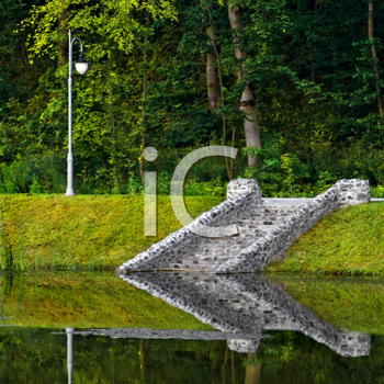 Royalty Free Photo of a Stone Staircase Reflected in the Water