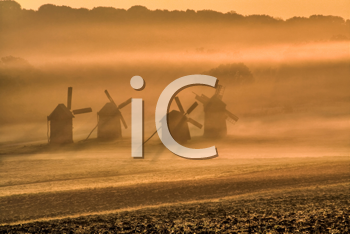 Royalty Free Photo of Windmills in the Fog