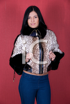 Royalty Free Photo of a Woman Wearing a Leopard Print Coat