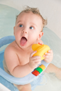 Royalty Free Photo of a Baby Getting a Bath