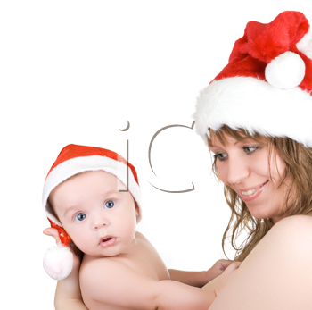 Royalty Free Photo of a Mother and Son Wearing Santa Hats