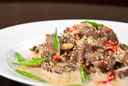 tasty dish of sliced beef roasted with vegetables