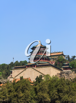 Beijing, China -May 2, 2015: The Summer Palace, Beijing, China. The Tower of Buddhist Incense with pavilions and stone staircase with visitors