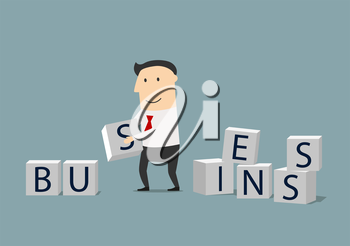 Build your own business or startup concept. Smiling focused businessman building a word Business from cubes with letters