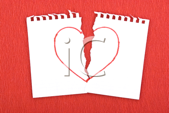 Royalty Free Photo of a Heart Drawn on a Torn Notebook Page
