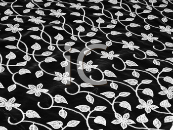 Close-up of Beautiful lacy tissue over black background