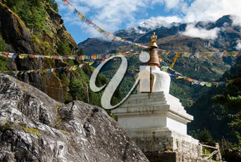 Buddhist stupe or chorten with prayer flags in Himalayas. Religion in Nepal