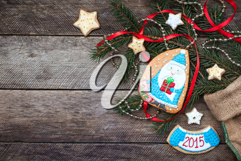 Christmas Santa in blue and New Year star cookies in rustic style on wood. Free space for text