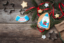 Cute Santa and New Year star cookies in rustic style on wood. Free space for text