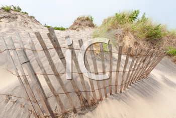 Royalty Free Photo of a Fence on a Sand Dune