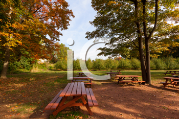 Royalty Free Photo of a Country Park Are With Tables