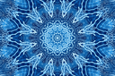 Blue background with concentric abstract pattern of soap foam on glass