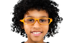 Portrait of a boy wearing eyeglasses and smiling isolated over white
