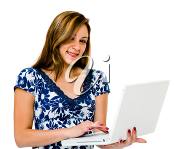 Portrait of a teenage girl using a laptop and smiling isolated over white