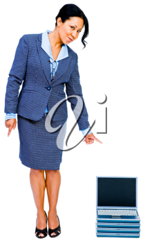 Portrait of a businesswoman pointing towards laptops and smiling isolated over white