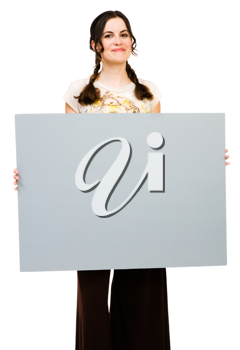 Smiling woman holding a placard and posing isolated over white