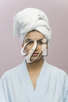 Portrait of a young woman with her head wrapped in a towel
