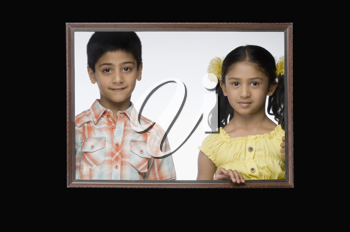 Portrait of a girl and a boy in a picture frame