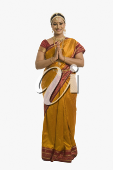 South Indian woman greeting with folded hands