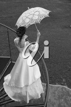 Royalty Free Photo of a Woman With an Umbrella
