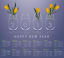 New year 2013 Calendar with conceptual image of yellow tulips in glass vases.