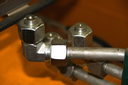 Connection hydraulic pipes and nuts with plug
