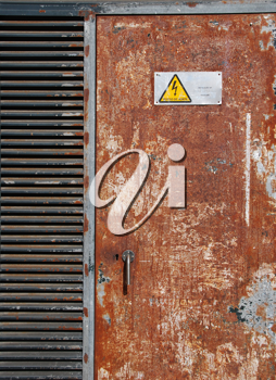 Royalty Free Photo of a Danger High Voltage Sign on a Rusty Metal Door