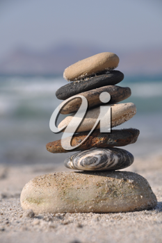 Royalty Free Clipart Image of a Pebble Stack on Kos Beach