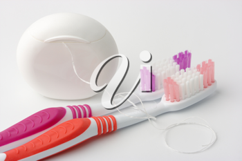 Royalty Free Photo of Toothbrushes and Floss