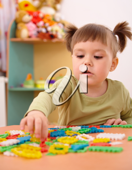 Royalty Free Photo of a Girl Playing With Toys