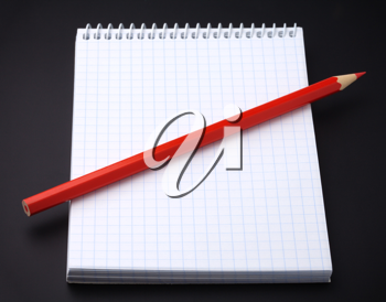 Royalty Free Photo of a Notebook and Pencil