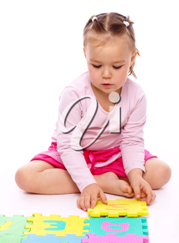 Royalty Free Photo of a Little Girl With a Foam Puzzle