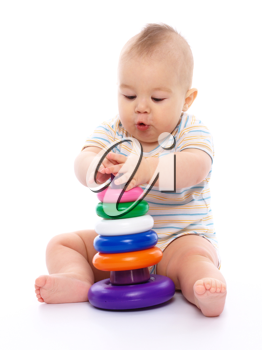 Royalty Free Photo of a Little Boy Playing With a Toy