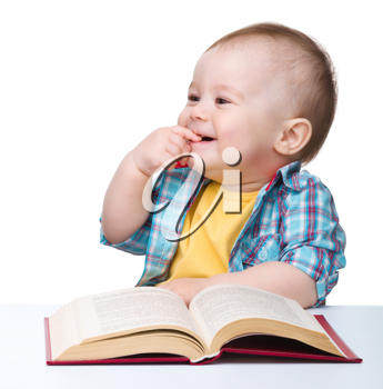 Royalty Free Photo of a Little Boy With a Book