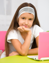 Royalty Free Photo of a Little Girl With a Pink Laptop
