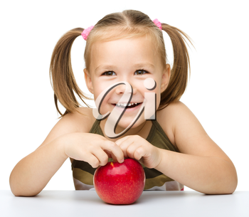 Portrait of a cute cheerful little girl with red apple, isolated over white