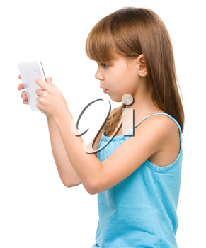 Young girl is using tablet, isolated over white