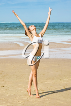 Royalty Free Photo of a Woman Exercising on the Beach