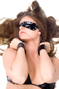 Royalty Free Photo of a Blindfolded Woman in Handcuffs