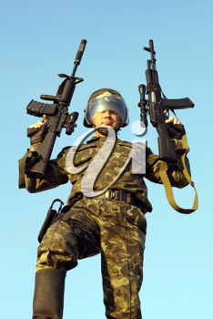 Royalty Free Photo of a Soldier With Guns