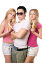 Royalty Free Photo of a Boy With Two Girls Eating Bananas