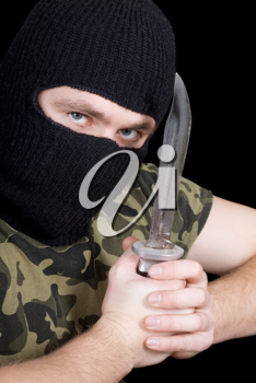 Royalty Free Photo of a Man Wearing a Balaclava Holding a Knife