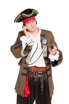 Portrait of young man in pirate costume talking on the phone. Isolated