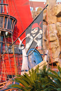 LAS VEGAS, NEVADA, USA - OCTOBER 21, 2013 : Pirate ship at pond near Treasure Island hotel  in Las Vegas. This Caribbean themed resort has an hotel with 2,884 rooms