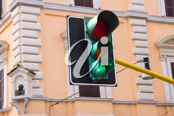 Traffic lights at the crossroads of the city is lit green