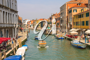 VENICE, ITALY - MAY 06, 2014: Active movement on a canal in sunny spring day,Venice, Italy
