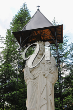 Schodnica, Ukraine - July 03, 2014: Statue of Virgin Mary, Mother of God in Carpathians